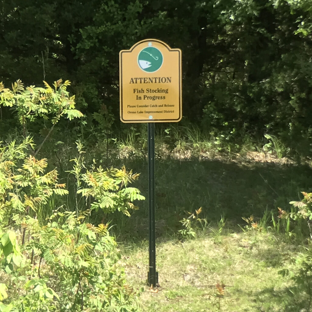 Fish stocking sign on cemetery point